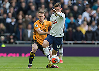 Football - 2019 / 2020 Premier League - Tottenham Hotspur vs. Wolverhampton Wanderers<br /> <br /> Giovani Lo Celso (Tottenham FC) holds off the attentions of Diogo Jota (Wolverhampton Wanderers) at The Tottenham Hotspur Stadium.<br /> <br /> COLORSPORT/DANIEL BEARHAM