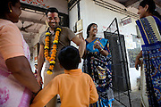 Jaume Sanllorente, the director general of Sonrisas de Bombay is talking to a child and his mother at a school run by the fast-growing Spanish NGO in Mumbai, India.