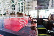 """A sign on a London Bus reading """"Please give our drivers some space and use another seat if possible"""", Wednesday, June 24, 2020.  Secretary of State for Transport Grant Shapps, announced that all passengers must wear face masks on public transport starting from 15 June and warned that wearing of a facemask would be a condition to travel and failure to comply will result to failure to travel or being fined. (Photo/ Vudi Xhymshiti)"""