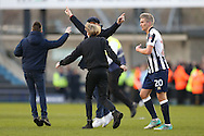 Millwall fans invade the pitch after full time as Millwall player Steve Morison walks off the pitch. The Emirates FA Cup 5th round match, Millwall v Leicester City at The Den in London on Saturday 18th February 2017.<br /> pic by John Patrick Fletcher, Andrew Orchard sports photography.