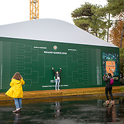 PARIS, FRANCE September 27. Spectators pose for photographs as they arrive for the start of play on a wet autumn day on day one of the French Open Tennis Tournament at Roland Garros on September 27th 2020 in Paris, France. (Photo by Tim Clayton/Corbis via Getty Images)