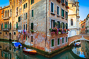 "The corner of a building in Venice, encircled by a small canal<br /> .....<br /> Venice is a city in northeastern Italy sited on a group of 118 small islands separated by canals and linked by bridges. It is located in the marshy Venetian Lagoon which stretches along the shoreline, between the mouths of the Po and the Piave Rivers. Venice is renowned for the beauty of its setting, its architecture and its artworks. The city in its entirety is listed as a World Heritage Site, along with its lagoon. Venice is the capital of the Veneto region. In 2009, there were 270,098 people residing in Venice's comune. Although there are no historical records that deal directly with the founding of Venice, tradition and the available evidence have led several historians to agree that the original population of Venice consisted of refugees from Roman cities near Venice such as Padua, Aquileia, Treviso, Altino and Concordia (modern Portogruaro) and from the undefended countryside, who were fleeing successive waves of Germanic and Hun invasions. Some late Roman sources reveal the existence of fishermen on the islands in the original marshy lagoons. They were referred to as incolae lacunae (""lagoon dwellers""). The traditional founding is identified with the dedication of the first church, that of San Giacomo at the islet of Rialto (Rivoalto, ""High Shore""), which is said to have been at the stroke of noon on 25 March 421."