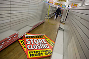 On the last day of trading, surrounded by empty shelves and shop fittings, sheets of closing down posters are seen lying on the shop floor in the Camberwell branch of Woolworths department store in London. In its 100th year, the iconic high street chain of affordable goods has welcomed generations of shoppers since its first outlet opened in 1909. In a period of financial turmoil when recession followed the credit crunch, Woolworths went into administration in November 2008 with debts of £385m Pounds. Its 815 nationwide outlets were forced to close and its 27,000 workers laid off.
