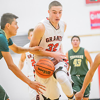 Thoreau Hawk Chaffus Yazzie (41), left, knocks possession from Grants Pirate Richie Lucero (32) during the Eddie Peña Holiday Classic at Grants High School Thursday.