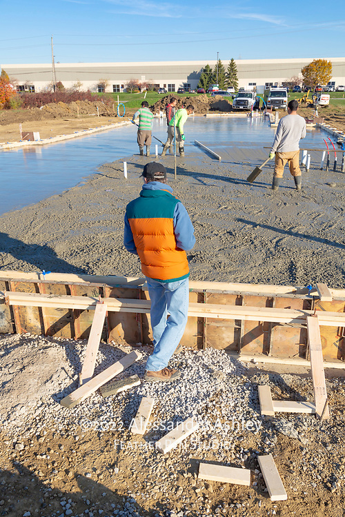 Mark Read, owner of Athletic Advantage, Inc., supervises slab pour at future site of new physical therapy and wellness center building in Lewis Center, Ohio.