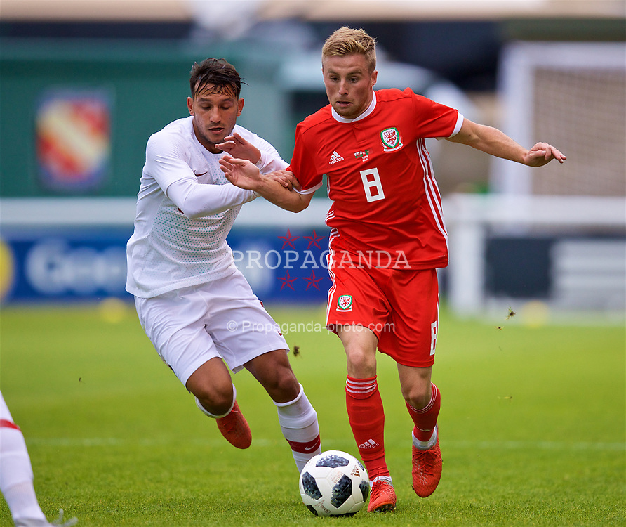 BANGOR, WALES - Tuesday, September 11, 2018: Wales' Joseff Morrell (right) and Portugal's João Carvalho during the UEFA Under-21 Championship Italy 2019 Qualifying Group B match between Wales and Portugal at the Nantporth Stadium. (Pic by David Rawcliffe/Propaganda)