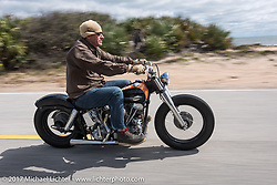 Eric Stein on his 1964 custom Harley-Davidson Panhead rodomg A1A near Flagler Beach during Daytona Beach Bike Week. FL. USA. Tuesday, March 14, 2017. Photography ©2017 Michael Lichter.