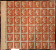 """Unused block of forty-two """"Penny Red-Brown"""" postage stamps of Queen Victoria<br /> issued February 10, 1841 After a design by William Wyon British"""