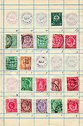A collection of old stamps from Jamaica Philately is the study of postage stamps and postal history.