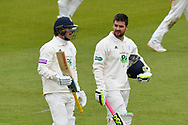 Sam Northeast of Hampshire and Rilee Rossouw of Hampshire walk back to the pavilion for tea during the first day of the Specsavers County Champ Div 1 match between Hampshire County Cricket Club and Essex County Cricket Club at the Ageas Bowl, Southampton, United Kingdom on 5 April 2019.