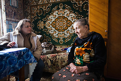 MSF doctor Svetlana Niekurasa checks 91-year-old Varvara Tutunik in her home in Debaltsevo. Two MSF home visit teams are visiting elderly and sick patients across the city following fierce fighting that has left them without medical care or access to medicines.