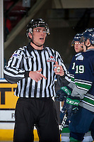 KELOWNA, CANADA - FEBRUARY 13: Linesman Tim Plamondon makes a call on the ice at the Kelowna Rockets against the Seattle Thunderbirds on February 13, 2017 at Prospera Place in Kelowna, British Columbia, Canada.  (Photo by Marissa Baecker/Shoot the Breeze)  *** Local Caption ***