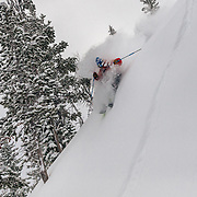 Tigger Knecht skis blower powder in the backcountry near JHMR during a major winter storm in the Tetons.