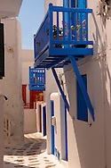 The narrow lanes with colourful houses of Mykonos Chora, Cyclades Island, Greece .<br /> <br /> Visit our GREEK HISTORIC PLACES PHOTO COLLECTIONS for more photos to download or buy as wall art prints https://funkystock.photoshelter.com/gallery-collection/Pictures-Images-of-Greece-Photos-of-Greek-Historic-Landmark-Sites/C0000w6e8OkknEb8