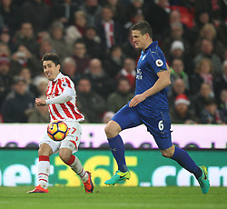 Bojan Krkic of Stoke City (L) and Robert Huth of Leicester City in action - Mandatory by-line: Jack Phillips/JMP - 17/12/2016 - FOOTBALL - Bet365 Stadium - Stoke-on-Trent, England - Stoke City v Leicester City - Premier League