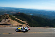 June 26-30 - Pikes Peak Colorado. Romain Dumas runs his car during practice for the 91st running of the Pikes Peak Hill Climb.