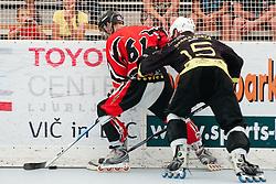 Klemen Cerar of HK Prevoje vs Andrej Tavzelj of DPH Itaksport.com Kranj at semifinal match of IZS Masters 2011 inline hockey between HK Prevoje and DPH Itaksport.com Kranj, on June 4, 2011 in Sportni park, Horjul, Slovenia. (Photo by Matic Klansek Velej / Sportida)