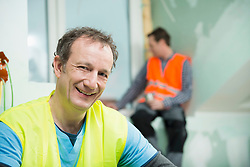 Portrait of construction worker at construction site of new building