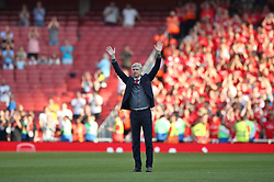 Arsenal manager Arsene Wenger salutes the fans after his final home game as manager during the Premier League match at the Emirates Stadium, London.