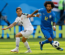 June 22, 2018 - Saint Petersburg, Russia - Marcelo (R) of Brazil national team and Cristian Gamboa of Costa Rica national team vie for the ball during the 2018 FIFA World Cup Russia group E match between Brazil and Costa Rica on June 22, 2018 at Saint Petersburg Stadium in Saint Petersburg, Russia. (Credit Image: © Mike Kireev/NurPhoto via ZUMA Press)