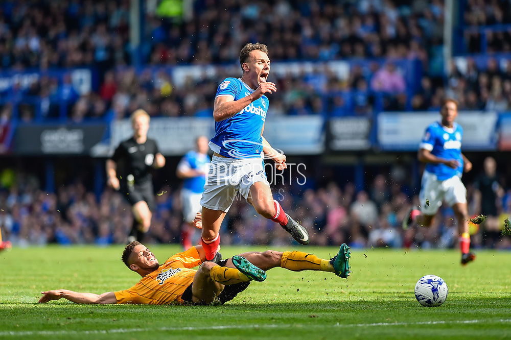 Cambridge United Defender, Jake Carroll (19) tackles Portsmouth Midfielder, Kal Naismith (22) during the EFL Sky Bet League 2 match between Portsmouth and Cambridge United at Fratton Park, Portsmouth, England on 22 April 2017. Photo by Adam Rivers.