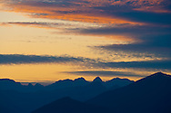 Post sunset alpenglow lights the sky over the northeastern region of the Olympic Mountains in Washington, USA.