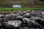 Rocky boulders that have fallen from cliffs above are seen in front of Tigh SgeirGael - built in 2005 – a self catering cottage sitting just 50 metres from the sea under the magnificent Gribun cliffs at Gribun, Isle of Mull, Scotland. (http://www.accommodationsmull.co.uk/gribun/). The rocky shore nearby are sandstones deposited in a desert region at the same sort of latitude and rather like the Persian Gulf today.