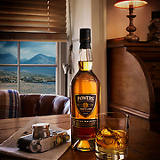 Whiskey bottle and glass on a table and a view of mountains in the background Ray Massey is an established, award winning, UK professional  photographer, shooting creative advertising and editorial images from his stunning studio in a converted church in Camden Town, London NW1. Ray Massey specialises in drinks and liquids, still life and hands, product, gymnastics, special effects (sfx) and location photography. He is particularly known for dynamic high speed action shots of pours, bubbles, splashes and explosions in beers, champagnes, sodas, cocktails and beverages of all descriptions, as well as perfumes, paint, ink, water – even ice! Ray Massey works throughout the world with advertising agencies, designers, design groups, PR companies and directly with clients. He regularly manages the entire creative process, including post-production composition, manipulation and retouching, working with his team of retouchers to produce final images ready for publication.