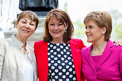 © Licensed to London News Pictures. 23/05/2016. London, UK. Caroline Lucas MP for The Green Party, Plaid Cymru leader Leanne Wood and Scottish First Minister and Leader of the SNP Nicola Sturgeon posing in front of Emmeline Pankhurst memorial statue in Victoria Tower Gardens in London on Monday, 23 May 2016 as they make the progressive case in favour of a Remain vote in next month's EU Referendum. Photo credit: Tolga Akmen/LNP
