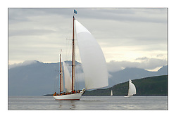 Belle Adventure, a 94' Bermudan Ketch built by Wm Fife in 1929 drifts up the Clyde as the clouds lift off Arran...This the largest gathering of classic yachts designed by William Fife returned to their birth place on the Clyde to participate in the 2nd Fife Regatta. 22 Yachts from around the world participated in the event which honoured the skills of Yacht Designer Wm Fife, and his yard in Fairlie, Scotland...FAO Picture Desk..Marc Turner / PFM Pictures