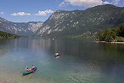 Canoes head out into lake Bohinj from at Ribcev Laz, on 19th June, in Lake Bohinj, Sovenia