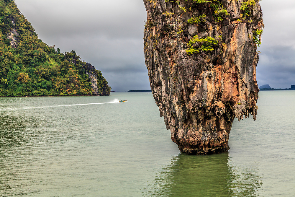 Limestone karst at Phang Nga Bay, Thailand. A distinctive peculiarity of Phang Nga Bay is the sheer limestone karsts that jut vertically out of the emerald-green water.