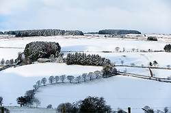 © Licensed to London News Pictures. 17/01/2015. Trees make a question mark in the snowy winter landscape. There was overnight snowfall on high land in Mid Wales. Mynydd Epynt, Powys , Wales, UK. Photo credit: Graham M. Lawrence/LNP
