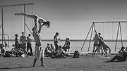 Gymnasts, showmen, athletes and exercise fans work out on the evocative sands in Sanata Monica near to Muscle Beach.