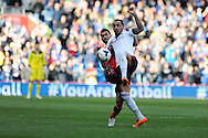 Fulham's Konstantinos Mitroglou ® is challenged by Cardiff's Steven Caulker.Barclays Premier league, Cardiff city v Fulham at the Cardiff city Stadium in Cardiff , South Wales on Sat 8th March 2014. pic by Andrew Orchard, Andrew Orchard sports photography