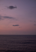 Pastel colored sky and clouds over the Pacific Ocean at dawn.  Image 18 of 21  for a panorama taken with a Fuji X-T1 camera and 35 mm f/1.4 lens  (ISO 400, 35 mm, f/2.8, 1/30 sec). Raw images processed with Capture One Pro and stitched together with AutoPano Giga Pro.