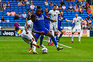 Bournemouth defender Jordan Zemura  (33) under pressure from Cardiff City midfielder Leandro Bacuna  (7) during the EFL Sky Bet Championship match between Cardiff City and Bournemouth at the Cardiff City Stadium, Cardiff, Wales on 18 September 2021.