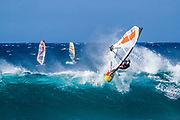 Windsurfing on overhead waves at Ho'okipa.