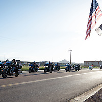 After their safety briefing and prayers, riders drive west on Church Rock St.as they continue their journey to the Vietnam Veterans Memorial in Washington D.C. early Friday morning In Gallup.