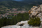 View looking down on the medieval village of Lagrasse, Languedoc-Roussillon, France. It lies in the valley of the River Orbieu and is famous for it's stone bridge and The Abbey of St. Mary of Lagrasse (French: Abbaye Sainte-Marie de Lagrasse or Abbaye Sainte-Marie-d'Orbieu) a Romanesque Benedictine abbey.