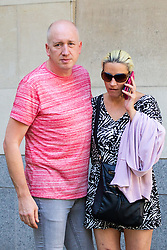 Gary Hilton, 46, and his partnerTracey McCarthy, 39, leave Westminster Magistrates Court after receiving a suspended sentence for harassing Family Judge Carol Atkinson. London, August 03 2018.