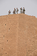 Soldiers on top of the Zigguart in Ur, Iraq after an Easter service Sunrise Easter Service was held  at the Biblical birthplace of Abraham near the Ziggurat, next to the Tallil Airbase in Iraq.<br /> Ur was the principal center of worship of the Sumerian moon god Nanna. The Ziggurat in Ur is the largest in Iraq . Next to it are the ruins of  what is thought to be Abraham's home. The archeological site will be returned to the Iraqis May 13 2009 along with the rest of Dhi Qar province