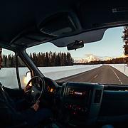 Andrew McCarthy drives towards Yellowstone at sunrise.