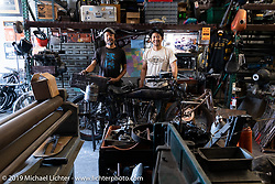 Shinya Kimura and his close friend Niimi (Yoshimasa Niimi) pause as they work on Shinya's 1915 Indian that they will both ride coast to coast (alternating days) in the September 2018 Cannonball-V. Chabott Engineering, Azusa, CA. USA. Wednesday June 27, 2018. Photography ©2018 Michael Lichter.