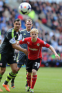 Cardiff city's Mats Daehli holds off Stoke's Geoff Cameron. Barclays Premier league match, Cardiff city  v Stoke city at the Cardiff city stadium in Cardiff, South Wales on Saturday 19th April 2014. pic by Andrew Orchard, Andrew Orchard sports photography,