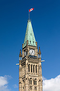 The Canadian flag and the top of the Peace Tower at the Parliament Building of Canada (Centre Block) in Ottawa, Ontario, Canada. The Peace Tower is 92.2 m (302 ft ) in height and was completed in 1927 after the original tower (Victoria Tower) burned down with the rest of the original Centre Block building in 1916.