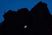 A climber at night on a rock route in Eldorado Canyon State Park, Colorado.