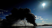 Savannah firefighters work a fire at the Ocean Terminal at the Georgia Ports Authority, Saturday, Feb. 8, 2014, at the Garden City Terminal near Savannah, Ga.  (Photo/Stephen B. Morton)