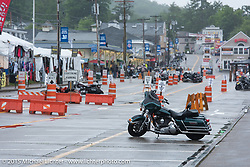 A cold wet day in Weirs Beach kept the crowds down during this day of Laconia Motorcycle Week. Laconia, NH, USA. June 15, 2015.  Photography ©2015 Michael Lichter.