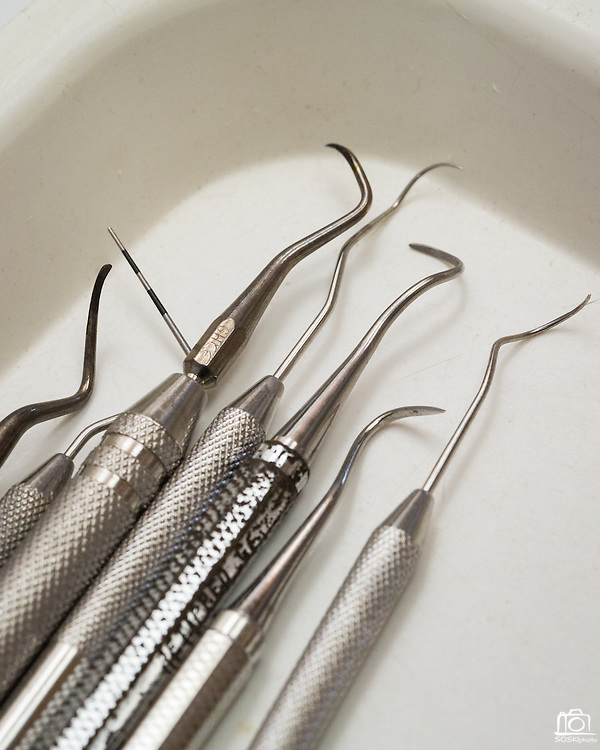 Dental instruments sit in a  tray during a dental cleaning at Justin L Cheng & Wesley Murakami, DDS, in Fremont, California, on April 9, 2014 (Stan Olszewski/SOSKIphoto)
